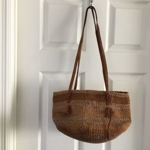 African woven jute market bag with leather straps